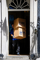 © Licensed to London News Pictures. 16/07/2016. London, UK. Boxes coming out of number 10 downing Street, the former residence of former prime minister David Cameron.  Removal men begin to take items from numbers 10 and 11 at Downing Street at the end of the week that saw Prime Minister David Cameron leave and Theresa May arrive. Photo credit: Ben Cawthra/LNP