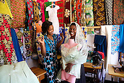 "Rahab Mbuba discussing dress designs with a customer.<br /> <br /> Rahab, also known as 'Mama B"", set up and now runs a tailoring business, designing and making clothes.<br /> <br /> She attended MKUBWA enterprise training run by the Tanzania Gatsby Trust in partnership with The Cherie Blair Foundation for Women."