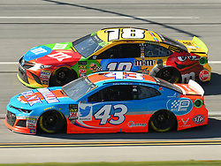 October 14, 2018 - Talladega, AL, U.S. - TALLADEGA, AL - OCTOBER 14: Darrell Wallace Jr., Richard Petty Motorsports, Chevrolet Camaro Medallion Bank/Petty's Garage (43) and Kyle Busch, Joe Gibbs Racing, Toyota Camry M&M's (18) race side by side during the 1000Bulbs.com 500 on October 14, 2018, at Talladega Superspeedway in Tallageda, AL.(Photo by Jeffrey Vest/Icon Sportswire) (Credit Image: © Jeffrey Vest/Icon SMI via ZUMA Press)