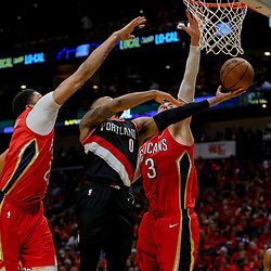 Apr 21, 2018; New Orleans, LA, USA; New Orleans Pelicans forward Anthony Davis (23) and forward Nikola Mirotic (3) defend Portland Trail Blazers guard Damian Lillard (0) during the second half in game four of the first round of the 2018 NBA Playoffs at the Smoothie King Center. Mandatory Credit: Derick E. Hingle-USA TODAY Sports