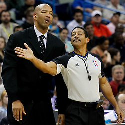 January 16, 2012; New Orleans, LA, USA; New Orleans Hornets head coach Monty Williams talks with referee Bennett Salvatore (15) during the third quarter of a game against the Portland Trail Blazers at the New Orleans Arena. The Trail Blazers defeated the Hornets 84-77.  Mandatory Credit: Derick E. Hingle-US PRESSWIRE