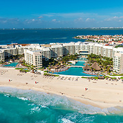 Aerial view of the Westin Lagunamar Cancun and shopping mall La Isla in the background.