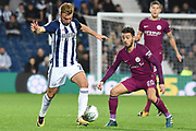 West Bromwich Albion midfielder James Morrison (7) holds the ball away from Manchester City midfielder Bernardo Silva (20) 0-1 during the EFL Cup match between West Bromwich Albion and Manchester City at The Hawthorns, West Bromwich, England on 20 September 2017. Photo by Alan Franklin.