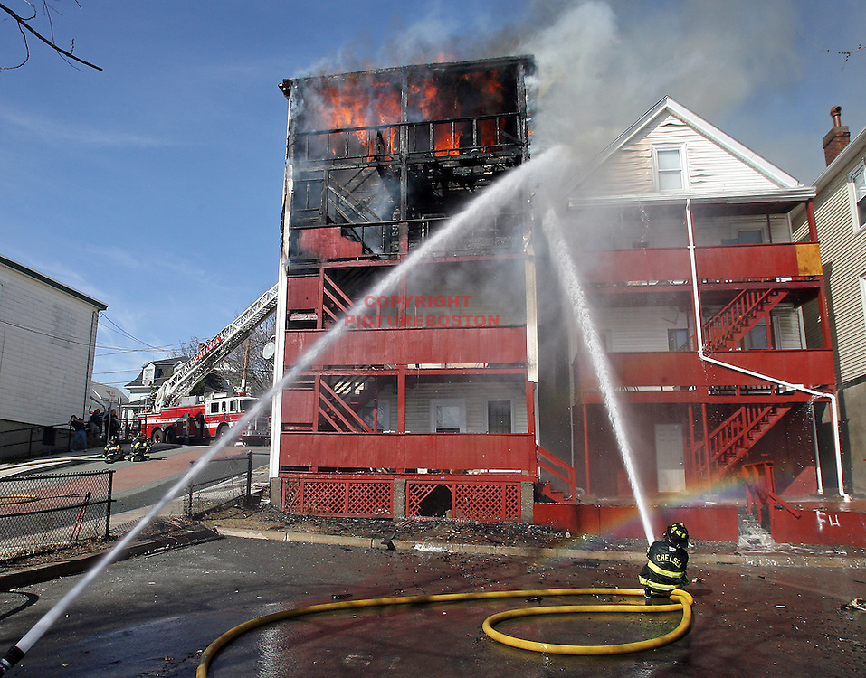(03/18/10-Chelsea,MA) 3-alarm fire at 31 Lewis Street in Chelsea mid-afternoon. Staff photo by Mark Garfinkel