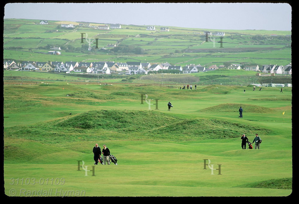 Golfers play the difficult, undulating links at Lahinch Golf Course, County Clare, Ireland.