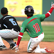 8/22/10 Aberdeen, MD: Mexico third baseman Sebastian Lizarraga (10) steals second base, Ocala Florida second baseman Jose Casillas (15) couldn't handle the throw from catcher Angel Camacho at The Cal Ripken World Series in Aberdeen MD. Credit: Saquan Stimpson/ Southcreek Global