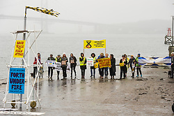 Environmental campaigners, Members of Hands Over Our Forth (HOOF), Scotland Against Fracking and SNP Members Against Uncoventional Gas gathered at the Forth Bidges todaye to unveil a banner ahead of Sunday's demonstration against coal gasification.<br /> © Ger Harley/ StockPix.eu