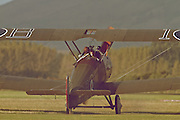 "A Sopwith Camel prepares to take-off from Hood Aerodrome, New Zealand. Introduced in 1917, the Sopwith Camel became the stand-out Allied fighter in the First World War. These flight demonstrations and static displays were part of the 2012 commemoration of ANZAC Day by The Vintage Aviator in Masterton, New Zealand. ANZAC (Australian and New Zealand Army Corps) Day is observed to remember ANZACs who served at Gallipoli during World War 1 and more generally all those who served and died for their countries. The Vintage Aviator Ltd is an aircraft restoration company and manufacturer based in New Zealand. On their website, thevintageaviator.co.nz, The Vintage Aviator list their primary aim as ""to build WW1 aircraft, engines and propellers to the same exacting standards they were originally made over 90 years ago"". The Vintage Aviator now boasts a fleet of WW1 aircraft including those originally made by Albatros, Fokker, Sopwith, Bristol, Nieuport and the Royal Aircraft Factory."