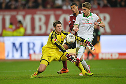 08.03.2014, easyCredit Stadion, Nuernberg, GER, 1. FBL, 1. FC Nuernberg vs SV Werder Bremen, 24. Runde, im Bild Patrick Rakovsky (1 FC Nuernberg / links) kann den Ball vor Nils Petersen (Werder Bremen / rechts) abwehren Hinten: Martin Angha (1 FC Nuernberg) Duell, Zweikampf, Action / Aktion // during the German Bundesliga 24th round match between 1. FC Nuernberg and SV Werder Bremen at the easyCredit Stadion in Nuernberg, Germany on 2014/03/08. EXPA Pictures © 2014, PhotoCredit: EXPA/ Eibner-Pressefoto/ Merz<br /> <br /> *****ATTENTION - OUT of GER*****