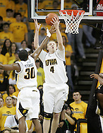 26 NOVEMBER 2007: Iowa guard/forward J.R. Angle (4) and Iowa guard Jeff Peterson (30) grab a rebound in Wake Forest's 56-47 win over Iowa at Carver-Hawkeye Arena in Iowa City, Iowa on November 26, 2007.