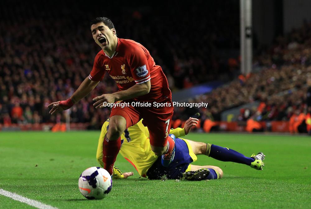 26th March 2014 - Barclays Premier League - Liverpool v Sunderland - Santiago Vergini of Sunderland fouls Luis Suarez of Liverpool - Photo: Simon Stacpoole / Offside.
