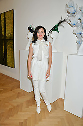 EVA LANSKA at a private view and auction of millinery organised by author, philanthropist and hat collector Eva Lanska in aid of Women for Women International held at Pace, Burlington Gardens, London on 10th June 2015.