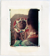 Maasai woman shows off mirror she has just made, Kenya<br />