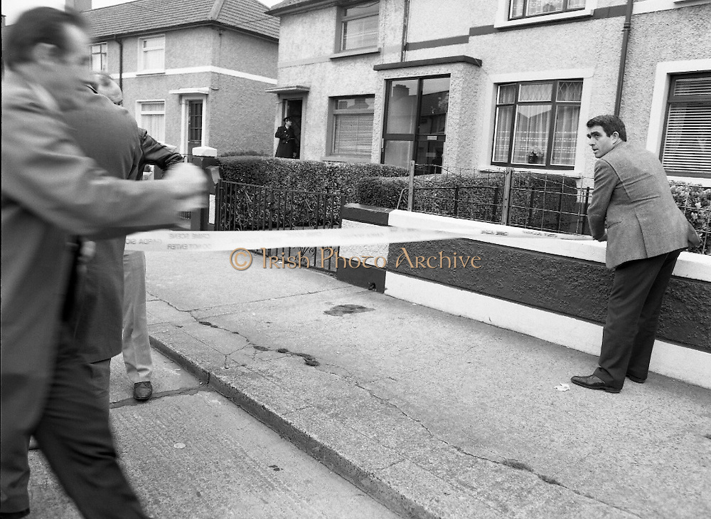 """John O'Grady Rescued By Gardai.   (R67)..1987..05.11.1987..11.05.1987..5th November 1987..After being kidnapped from his home in Cabinteely, Co Dublin, John O'Grady was finally rescued after twenty one days in captivity. he was located in a house inCarnlough Road, Cabra West, Dublin. During his ordeal Mr O""""Grady was mutilated by the kidnappers led by Dessie O'Hare to apply pressure on his family to pay the ransom sought. In an ensuing gun battle with the kidnappers a detective garda was shot and seriously wounded. In the chaos that followed the kidnappers escaped and were not all captured for a further three weeks after a massive manhunt...Image shows Garda technical officers as they secure the scene for forensic tests."""