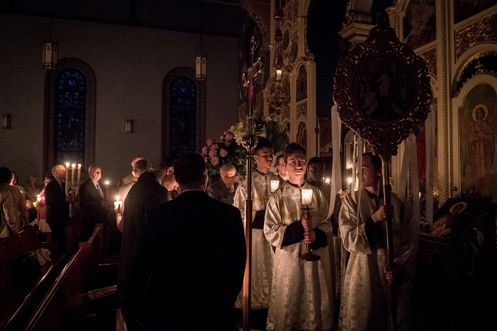 Parishioners participate in a resurrection matins service at Saint Nicholas Orthodox Church in Homestead, Pa. Saint Nicholas is a parish of the Orthodox Christian Faith and a member of the American Carpatho-Russian Orthodox Diocese of the United States.