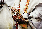 A Buddhist monk holds an implement used for prayer during a ritual in which participants walk barefoot across burning embers during a purification ceremony in Takao, west of Tokyo, Japan on Sunday 09 March  2009.