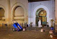 MARRAKESH, MOROCCO - CIRCA APRIL 2017: Man entering at the Grand Mosque Bab Doukkala in the Boulevard Fatima Zahra in Marrakesh. This is a local area close to the Medina.
