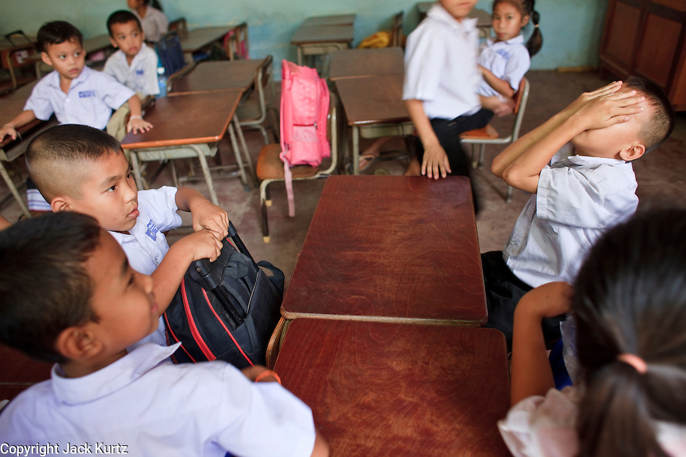 Mar. 10, 2009 -- VIENTIANE, LAOS: Children play in their classroom after classes at an elementary school in Vientiane, Laos.  Photo by Jack Kurtz / ZUMA Press
