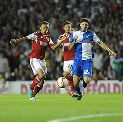Bristol City's Bobby Reid chases down the ball with pressure from Bristol Rovers' John-Joe OToole  - Photo mandatory by-line: Alex James/JMP - Tel: Mobile: 07966 386802 04/09/2013 - SPORT - FOOTBALL -  Ashton Gate - Bristol - Bristol City V Bristol Rovers - Johnstone Paint Trophy - First Round - Bristol Derby