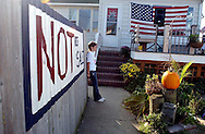 LONG BRANCH NJ - Daisy Hoaglang, pauses for a moment in her front yard as neighbors and simpathizers gatherer outsider her house to rally against eminent domain. Her mother Denisse Hoagland is one of the leaders of MTOTSA Alliance and their house is one on the list of the city's phase II redevelopment zone. (Photo by Miguel Juárez Lugo).