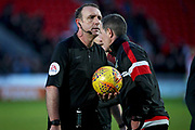 Referee Carl Boyeson leaves the field after a busy afternoon after the EFL Sky Bet League 1 match between Doncaster Rovers and Peterborough United at the Keepmoat Stadium, Doncaster, England on 9 February 2019.
