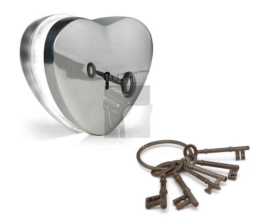 key unlocking a metal heart