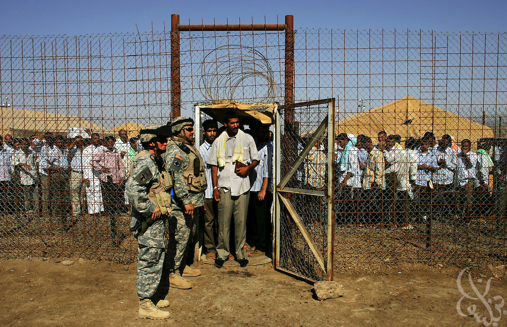 A group of about 450 Iraqi detainees are released by U.S. guards June 27, 2006 at the Abu Ghraib prison as part of a release scheduled under the national reconciliation plan of Iraqi Prime Minister Nouri al-Maliki.