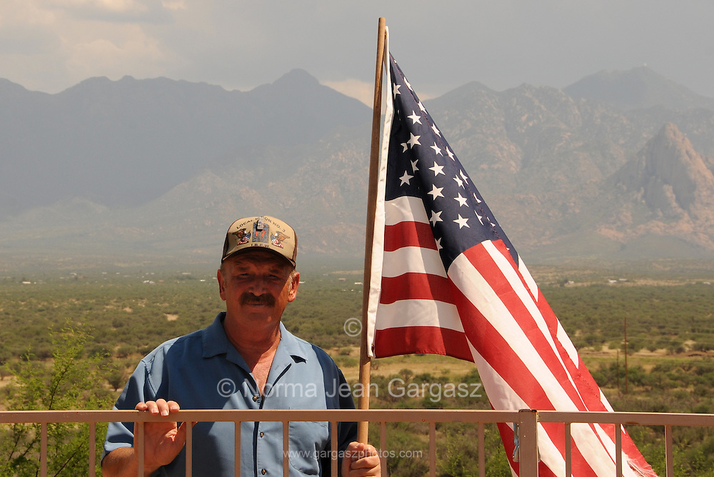 """Mario Potenzieri, a survivor of the terrorist attacks on the Twin Towers at the World Trade Center in New York on September11, 2001, flies the American flag at his home in Green Valley, Arizona, USA.  Potenzieri refers to the view of two mountains, Mount Hopkins and Mount Wrightson, from his home as """"my therapy room.""""  He suffered from post traumatic stress disorder after his ordeal."""