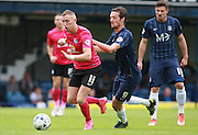 Peterborough United player Marcus Maddison gets the better of Southend player David Mooney during the Sky Bet League 1 match between Southend United and Peterborough United at Roots Hall, Southend, England on 5 September 2015. Photo by Bennett Dean.