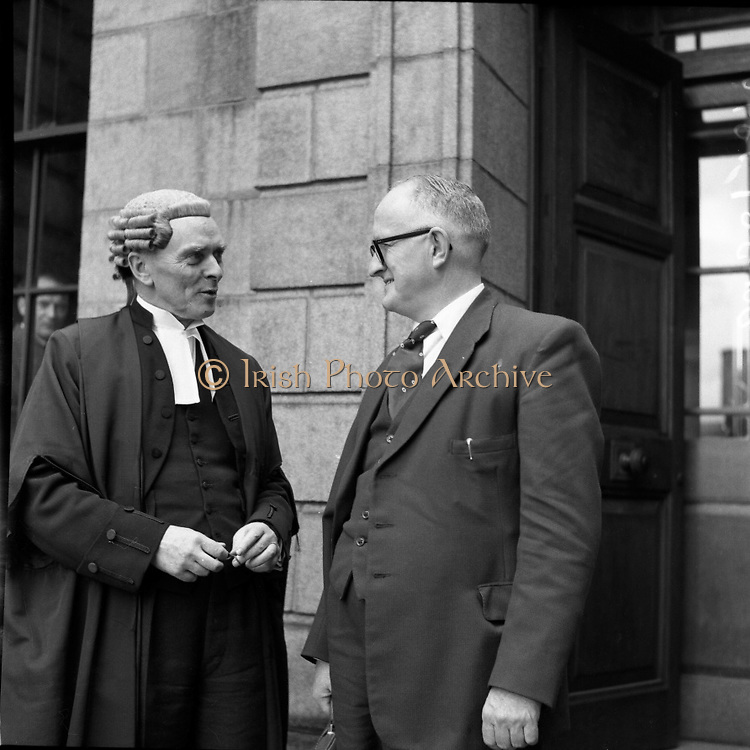 "Mr Louis O'Connell at High Court with his Barrister Mr Sean MacBride.  Court case in question was Lenihan vs O'Connell  (Special for Kerryman).12/05/1958..From Con Houlihan 'The back pages of village life'..http://www.independent.ie/opinion/columnists/con-houlihan/poetic-licence-1421362.html..'The Taxpayers' News', a magazine based in Kerry, was owned by Charlie Lenihan. He was a wealthy man that went into politics. Charlie got elected to the county council with a big majority and failed by a few hundred votes to get elected to the Dail. He would have won that election handsomely if he didn't despise number-two votes and told people who offered what to do with them. He had a drink problem and eventually it brought him to a rather early grave. ..One day on his way to Dublin to get the publication printed Mr Lenihan made changes to the text.  He referred to Louis O'Connell, a solicitor and a county councillor, as ""crooked in his business and in his politics"". A libel action followed in which Lenihan hadn't a hope. ..Sean McBride was representing Louis O'Connell and, of course, he won easily. Sean had a slight speech defect - he couldn't pronounce a certain consonant in the alphabet. He gave a hitch unto his gown and with a piercing look said: ""Come tell me, Mr Lenihan, did you call this man a cook?"" There was loud laughter until eventually we paid for it. The damages were heavy and eventually led to the demise of a brave little magazine. ...Seán MacBride (26/01/1904 – 15/01/1988) was an Irish government minister and prominent international politician as well as a Chief of Staff of the IRA..Rising from a domestic Irish political career, he founded or participated in many international as well as non-governmental organizations of the early 20th century, including the United Nations, the Council of Europe, and Amnesty International. He received the Nobel Peace Prize in 1974, the Lenin Peace Prize for 1975–76, and the UNESCO Silver Medal for Service in 198"