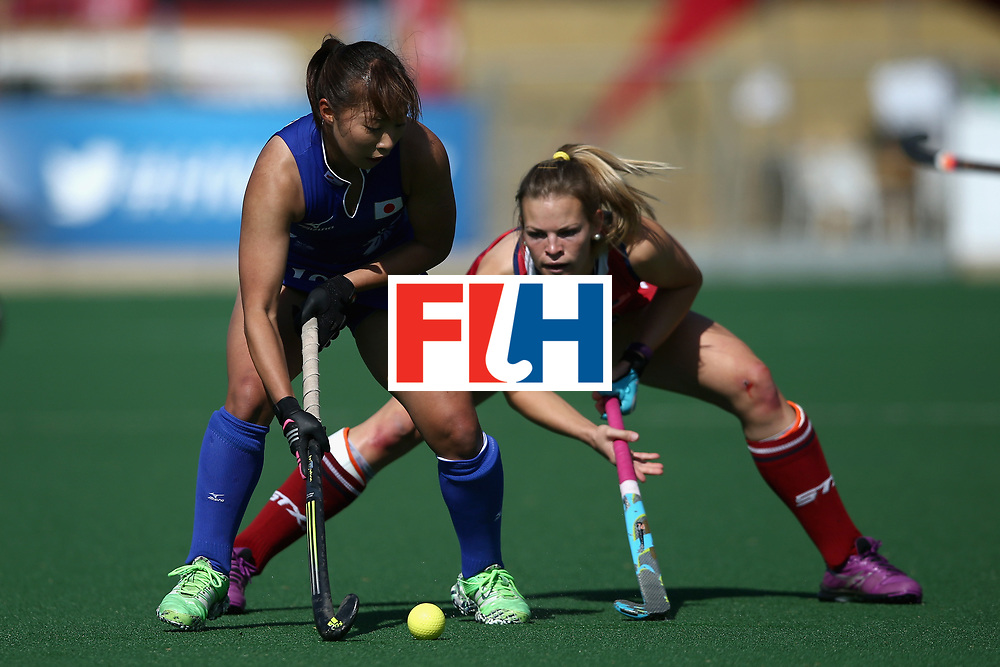 JOHANNESBURG, SOUTH AFRICA - JULY 18: Yukari Mano of Japan controls the ball while under pressure from Julia Young of the United States during the Quarter Final match between the United States and Japan during the FIH Hockey World League - Women's Semi Finals on July 18, 2017 in Johannesburg, South Africa.  (Photo by Jan Kruger/Getty Images for FIH)
