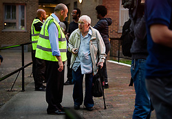© Licensed to London News Pictures. 23/06/2017. London, UK. An elderly man talks to a council official as residents are evacuated from the Taplow block of the Chalcots Estate in Camden after it failed a fire inspection because of combustable cladding. Prime Minister Theresa May has told Parliament that up to 600 high rise tower blocks may have similar cladding to that found in Grenfell Tower, which went on fire last week, in which as many as 79 residents are thought to have perished Photo credit: Ben Cawthra/LNP