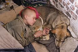 Teenage girl sleeping rough with dog,