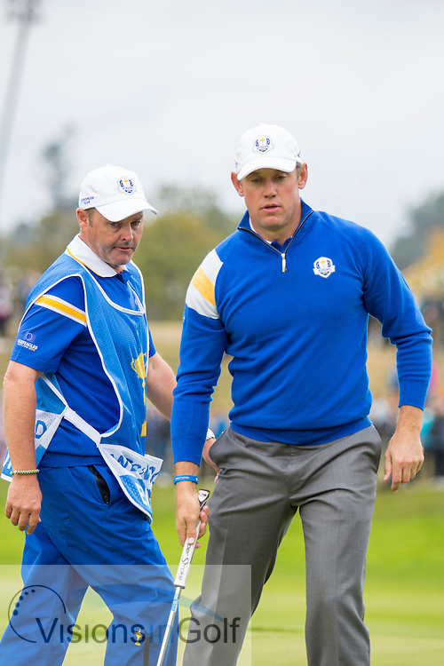 Jimmy Walker Lee Westwood<br /> on the 1st green<br /> on the 3rd day singles<br /> Ryder Cup 2014, Gleneagles, Scotland<br /> Picture Credit:  Mark Newcombe / visionsingolf.com