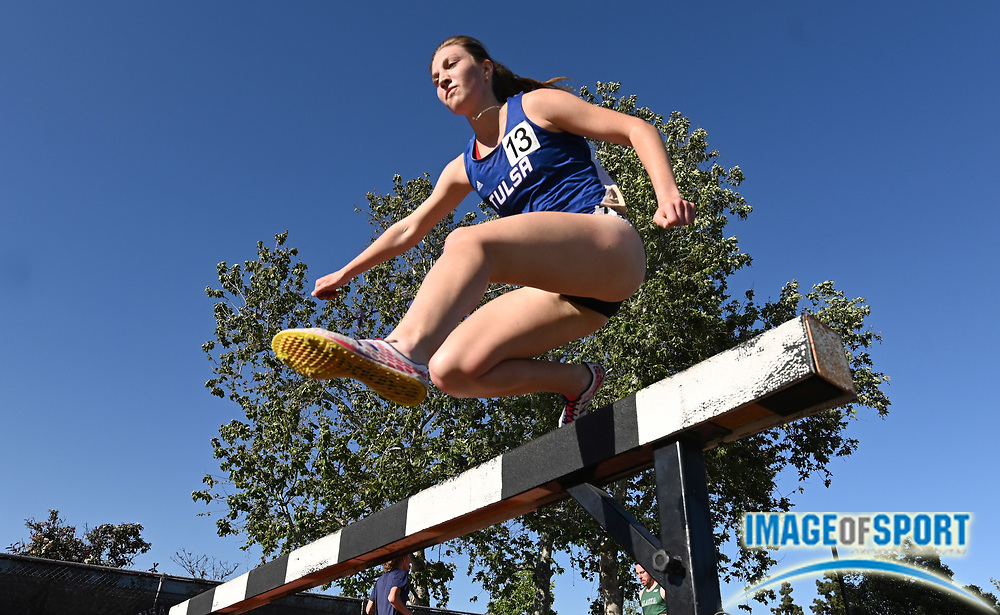 Apr 18, 2019; Azusa, CA, USA; Alyssa Bolliger of Tulsa hurdles a barrier in the women's steeplechase at the Bryan Clay Invitational at Azusa Pacific University.
