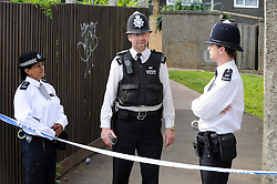 © Licensed to London News Pictures. 10/08/2012 . Police officers at the back  of 20 The Lindens the home of missing  Tia Sharps grandmother..  12 years old Tia Sharp has been missing from the Lindens on The Fieldway Estate in New Addington,Croydon,Surrey since Friday last week. .Photo credit : Grant Falvey/LNP
