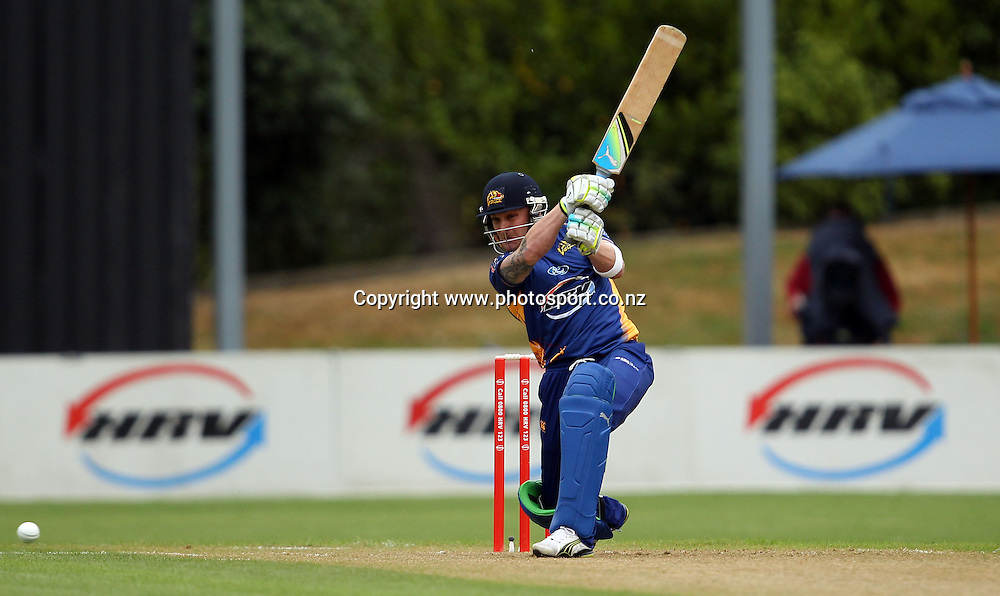 Brendon McCullum launches into a drive.<br /> Twenty20 Cricket - HRV Cup, Otago Volts v Canterbury Wizards, 13 January 2012, University Oval, Dunedin, New Zealand.<br /> Photo: Rob Jefferies/PHOTOSPORT