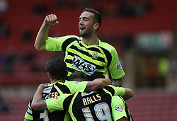 Yeovil Town's Shane Duffy celebrates Joel Grant  scoring the first goal - Photo mandatory by-line: Matt Bunn/JMP - Tel: Mobile: 07966 386802 14/12/2013 - SPORT - Football - Barnsley - Oakwell - Barnsley v Yeovil Town - Sky Bet Championship