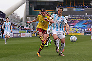 Burnley midfielder George Boyd (21)  crosses the ball in  during the Sky Bet Championship match between Huddersfield Town and Burnley at the John Smiths Stadium, Huddersfield, England on 12 March 2016. Photo by Simon Davies.