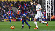 Yannick Bolasie holds off Daley Blind during the Barclays Premier League match between Crystal Palace and Manchester United at Selhurst Park, London, England on 31 October 2015. Photo by Michael Hulf.
