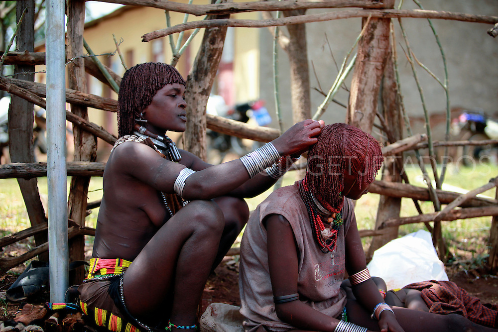 Hair grooming is paramount to Hamar concepts of beauty. Women roll their locks with fat and red ochre (assile) and then twist them into crimson-colored dreds called goscha, a style that men find attractive. There is a ritual word in Hamar called dansho which evokes abundance and overflowing growth of the fields, and some say dansho is also like the red buttery ringlets of a young woman's hair because they evoke a similar meaning. Exclusive at AuroraPhotos.<br /> http://www.auroraphotos.com/SwishSearch?Keywords=Ingetje+Tadros&amp;submit=Go!