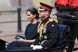 © Licensed to London News Pictures. 08/06/2019. London, UK.  Meghan, Duchess of Sussex and Prince Harry depart from Buckingham Palace during the Trooping the Colour ceremony to mark Queen Elizabeth II's 93rd birthday. Photo credit: Ray Tang/LNP