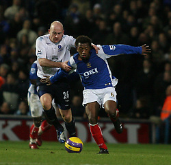 PORTSMOUTH, ENGLAND - SATURDAY, DECEMBER 9th, 2006: Manuel Fernandes of Portsmouth clashes with Lee Carsley of Everton during the Premiership match at Fratton Park. (Pic by Chris Ratcliffe/Propaganda)