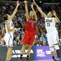 Apr 9, 2013; New Orleans, LA, USA; Louisville Cardinals guard Antonita Slaughter (4) shoots against Connecticut Huskies guard Bria Hartley (left) and forward Kaleena Mosqueda-Lewis (23) during the second half of the championship game in the 2013 NCAA womens Final Four at the New Orleans Arena. Mandatory Credit: Derick E. Hingle-USA TODAY Sports