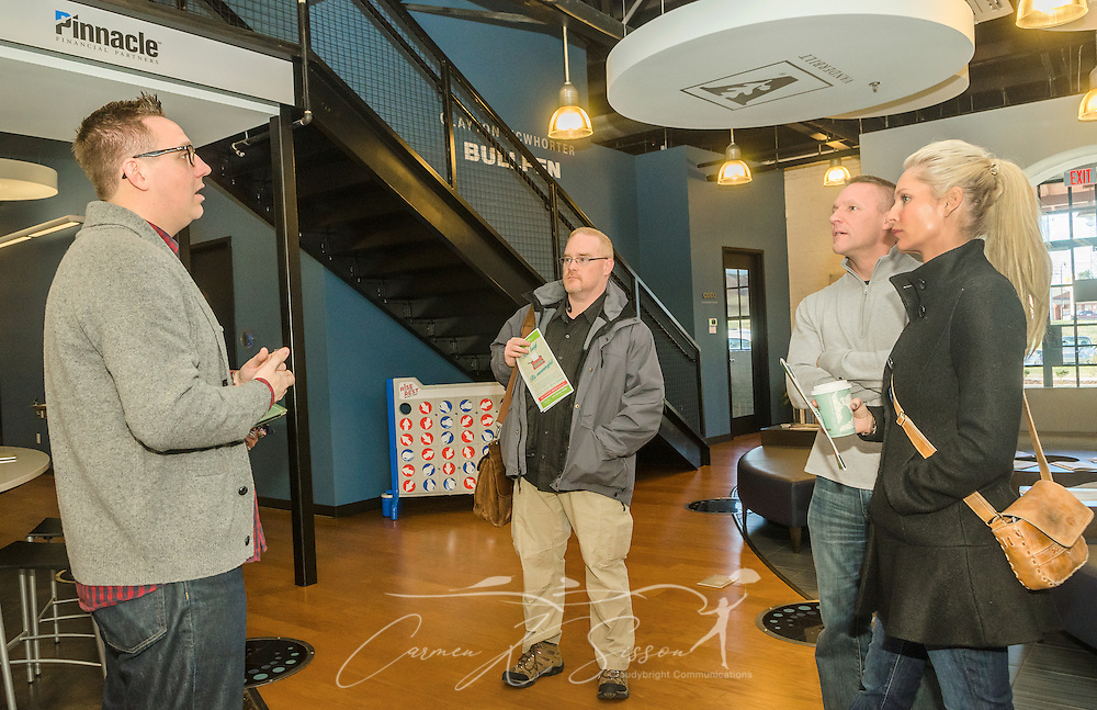 Robbie Goldsmith, director of community engagement at the Nashville Entrepreneur Center, explains the benefits of membership to Danny Dunn, Jase Tillman, and Brittany Lipscomb, Jan. 6, 2015, in Nashville, Tenn. The Entrepreneur Center has become the nucleus of a burgeoning startup movement — largely led by Millennials — in the city. (Photo by Carmen K. Sisson/Cloudybright)