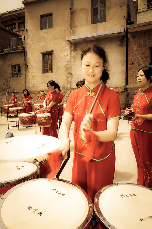 woman playing drums; marking end of fishing season;