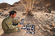 CACP guards setting up camera trap at tree used by cheetahs for scent-marking, Dar e Anjir, Iran