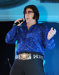 "© Licensed to London News Pictures. 07/01/2012. BIRMINGHAM, UK.  Sergeant Dave Walker of the Parachute Regiments takes part in the annual European Elvis Championship at the Hilton Metropole Hotel at the National Exhibition Centre today.  When Dave is not on duty he spends all of his spare time performing as an Elvis impersonator to raise money for the Parachute Regiment. ""At the end of the day Elvis was airbourne!"". Stated Dave after the show.  Photo credit: Alison Baskerville/LNP"