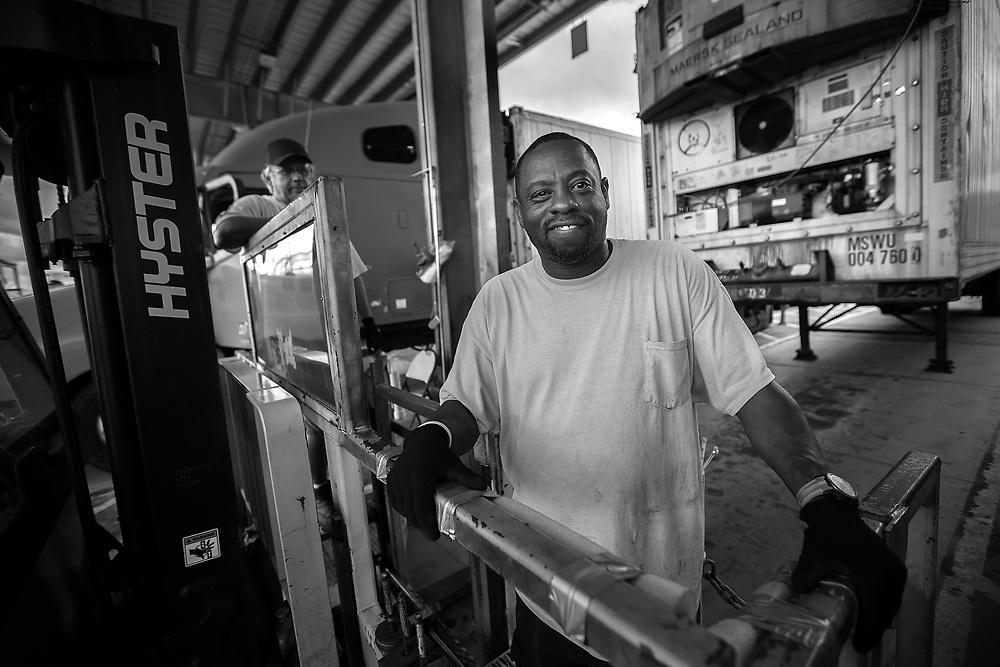 Members of the Port of Savannah ILA 2046 Reefer maintenance crew pose at the Georgia Ports Authority Garden City Terminal near Savannah, Ga.,  Wednesday, Aug. 31, 2016.  (GPA Photo/Stephen B. Morton)