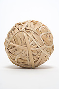 a brown rubber band ball